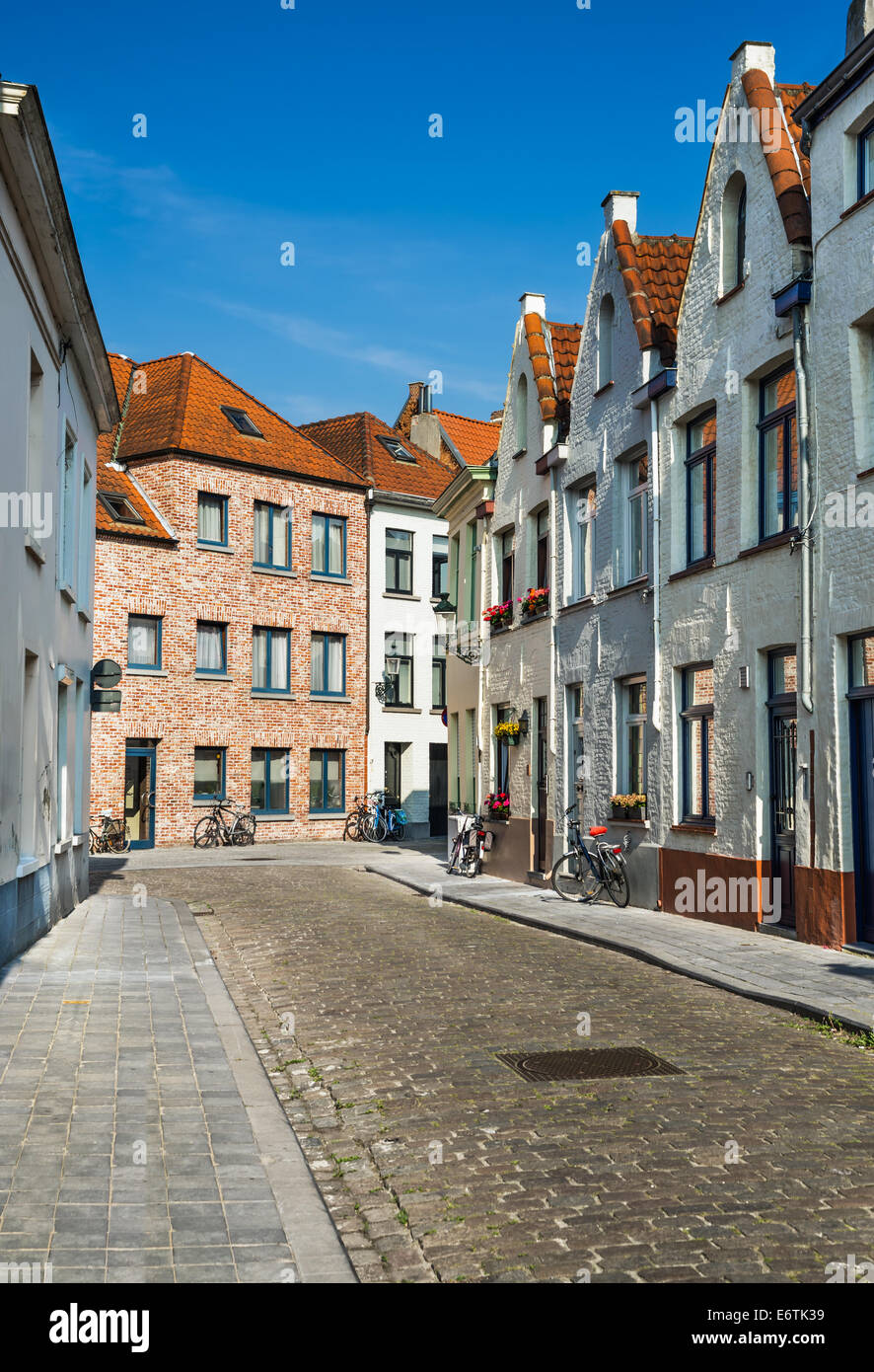 Medieval scenery with paved street and Belgium architecture houses in Bruges, landmark of Flanders. - Stock Image