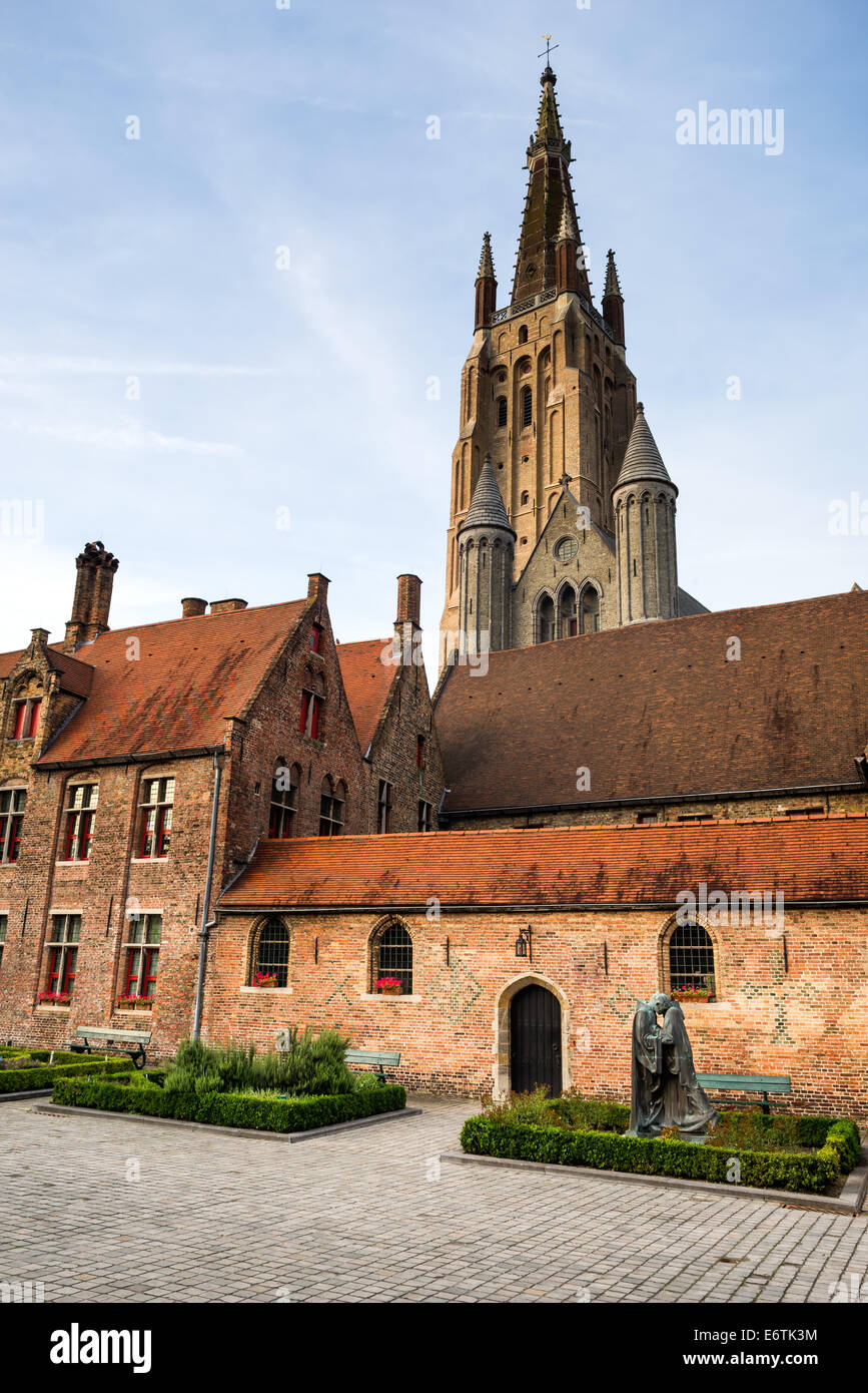 Bruges, Belgium. Church of Our Lady (Vrouwekerk) and Old St. John Hospital, West Flanders - Stock Image