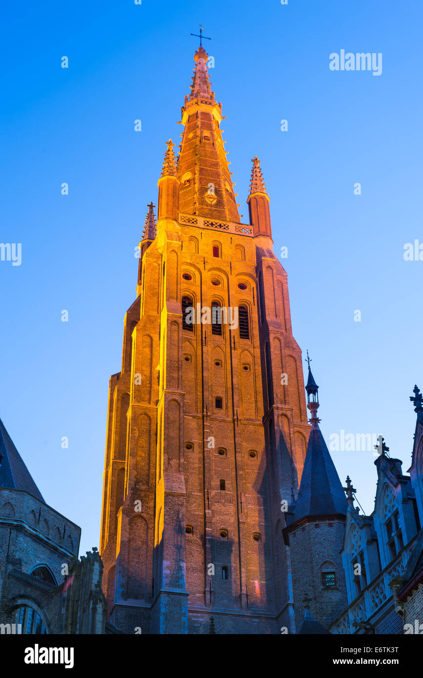 Bruges, Belgium. Gothic style spire of Church of Our Lady, Vrouwekerk, tallest in city with 122 m. West Flanders - Stock Image