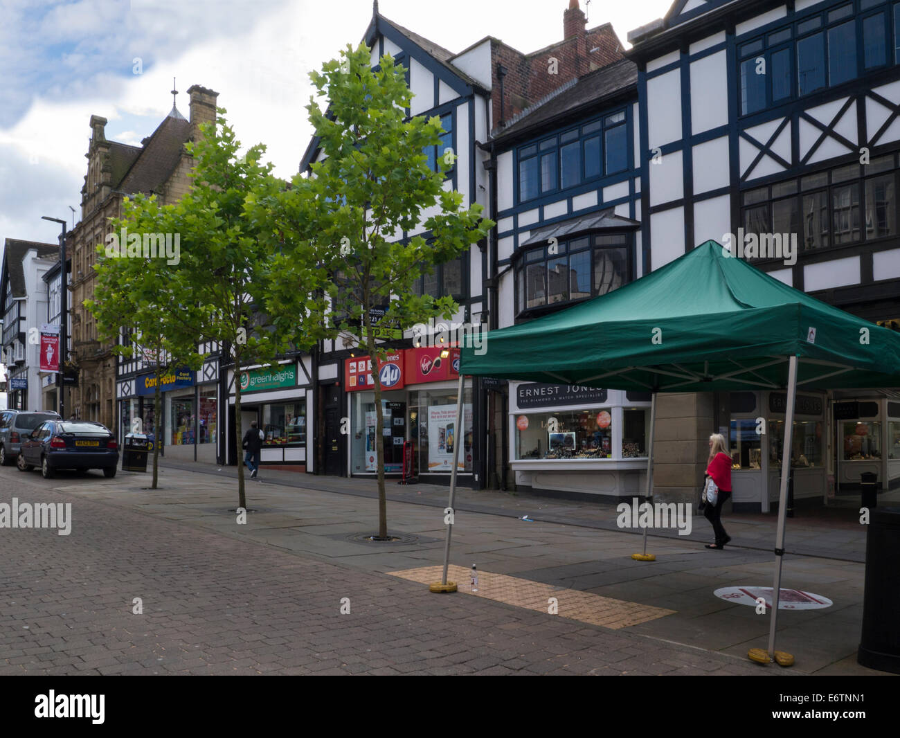 Shops in pedestrianised Standishgate Wigan town centre Greater Manchester England UK - Stock Image