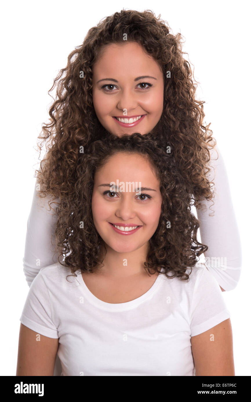 Real monozygotic twins with natural stop curls isolated over white background. - Stock Image