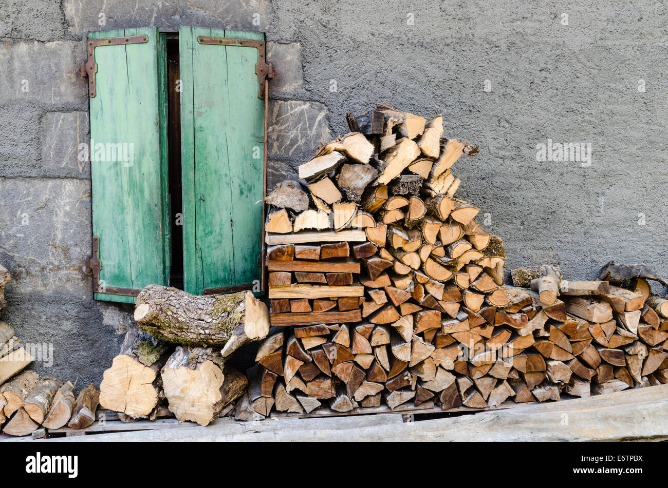 Stack of firewood outside a house - Stock Image