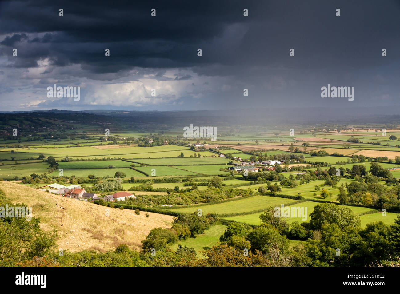 View of the Somerset levels from Glastonbury Tor with a moody sky - Stock Image