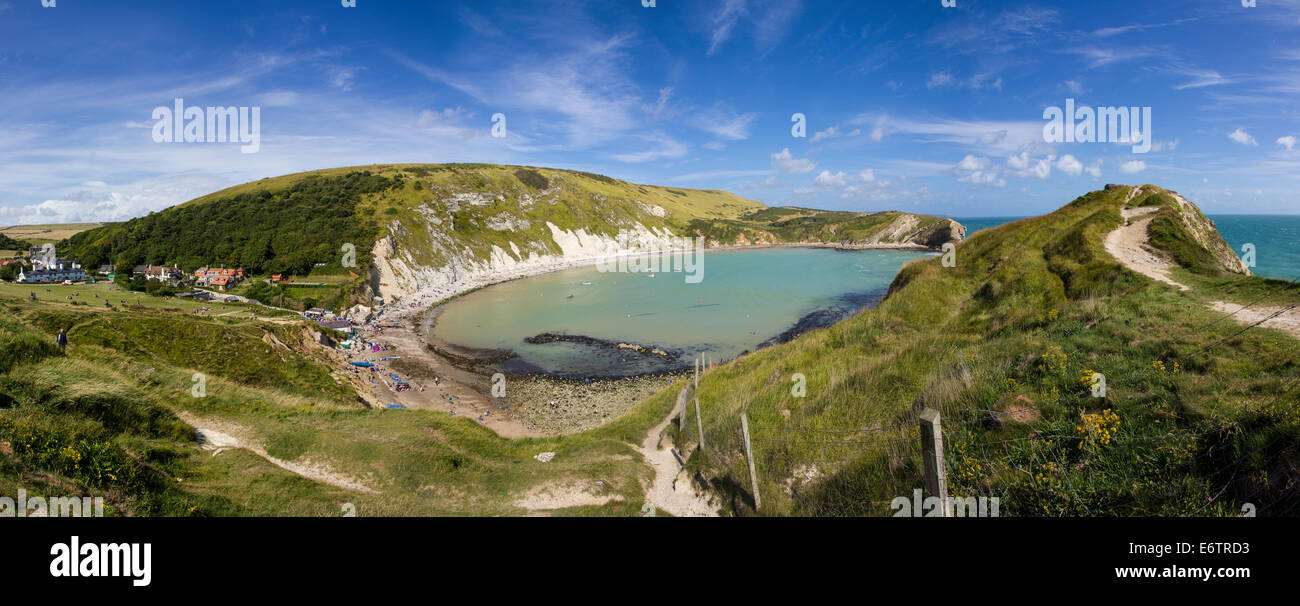 Panoramic wide shot of Lulworth Cove on the Jurassic Coast in Dorset England. - Stock Image