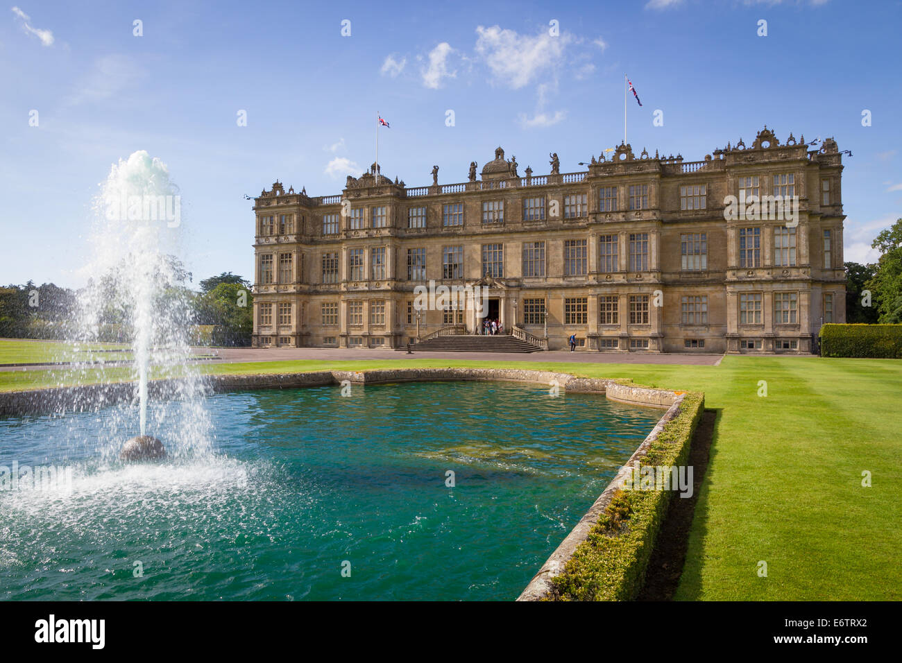Longleat House with lawn and fountain. Warminster, Wiltshire. - Stock Image