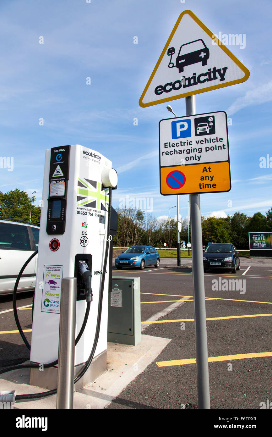 An Ecotricity electric vehicle charging point at Woolley Edge services on the M1 northbound at Wakefield, West Yorkshire, - Stock Image