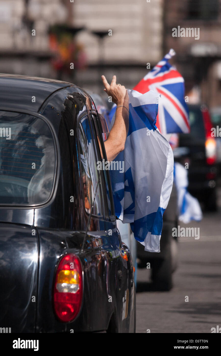London, UK. 31st Aug, 2014. Taxi drivers show their colours as as thousands of Jews and their supporters from London - Stock Image