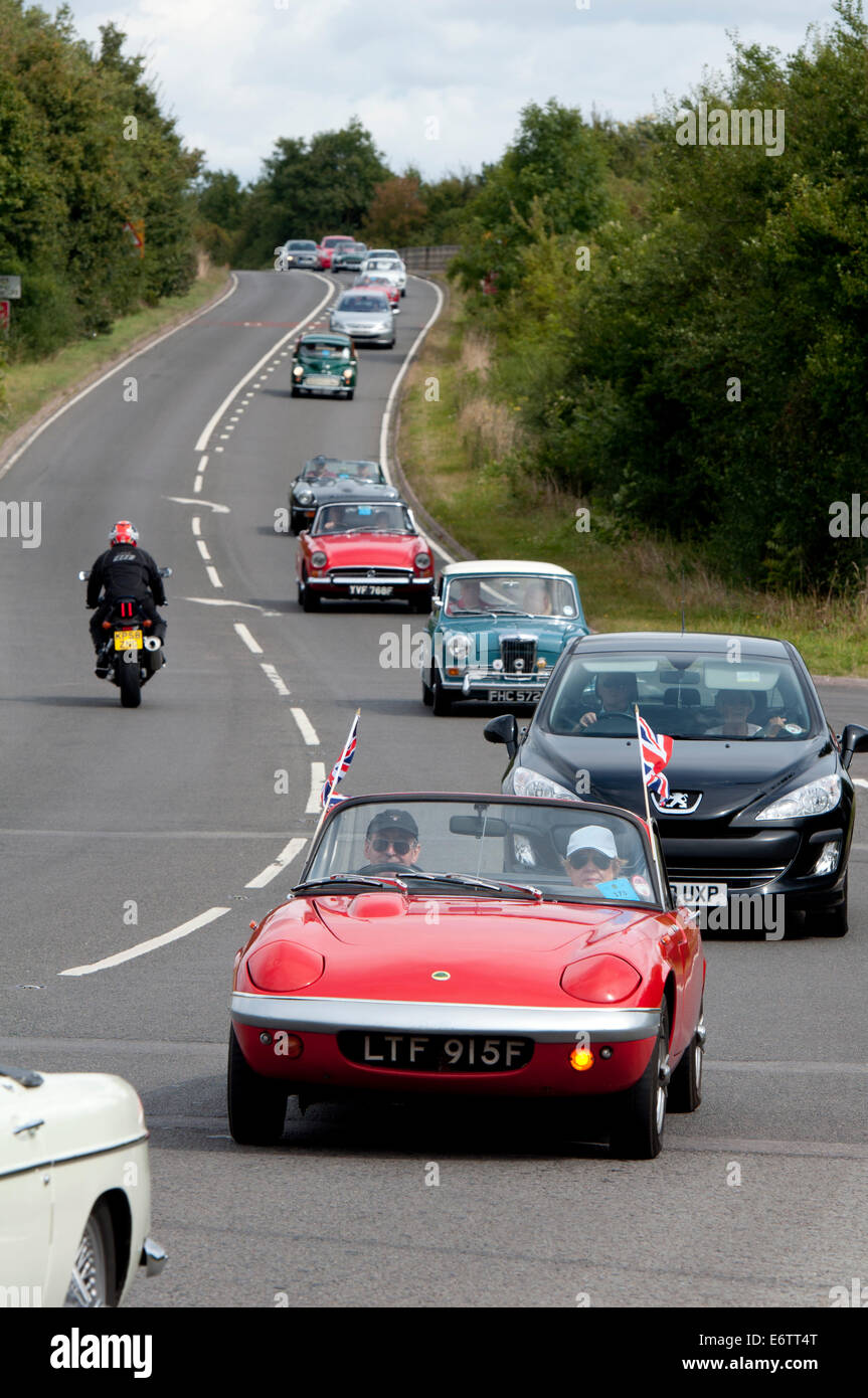 A Lotus Elan in a convoy of cars in the Coventry Festival of Motoring Historic Vehicle Run. Stock Photo