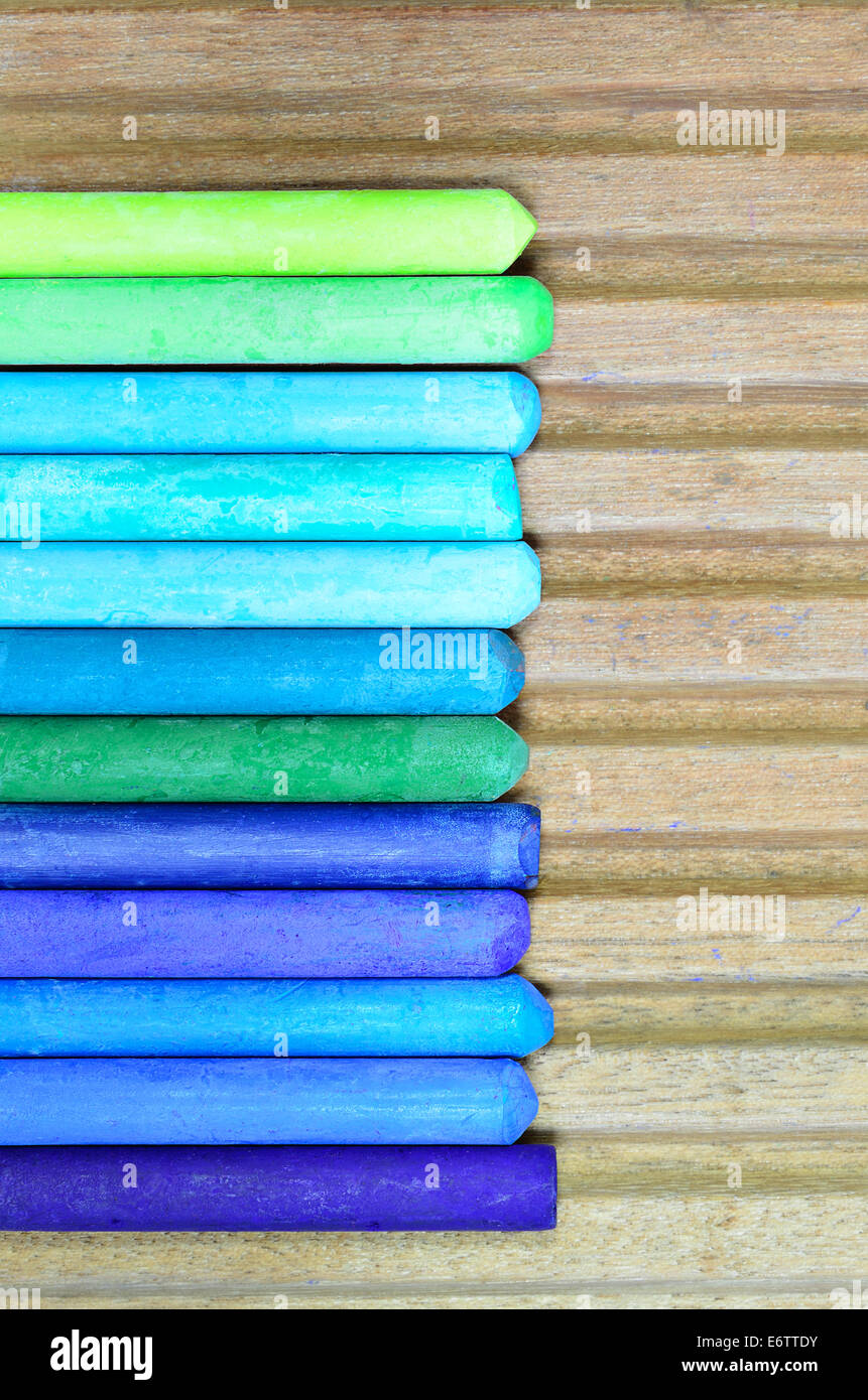 blue, green and cyan oil pastels, close up, macro, vertical - Stock Image