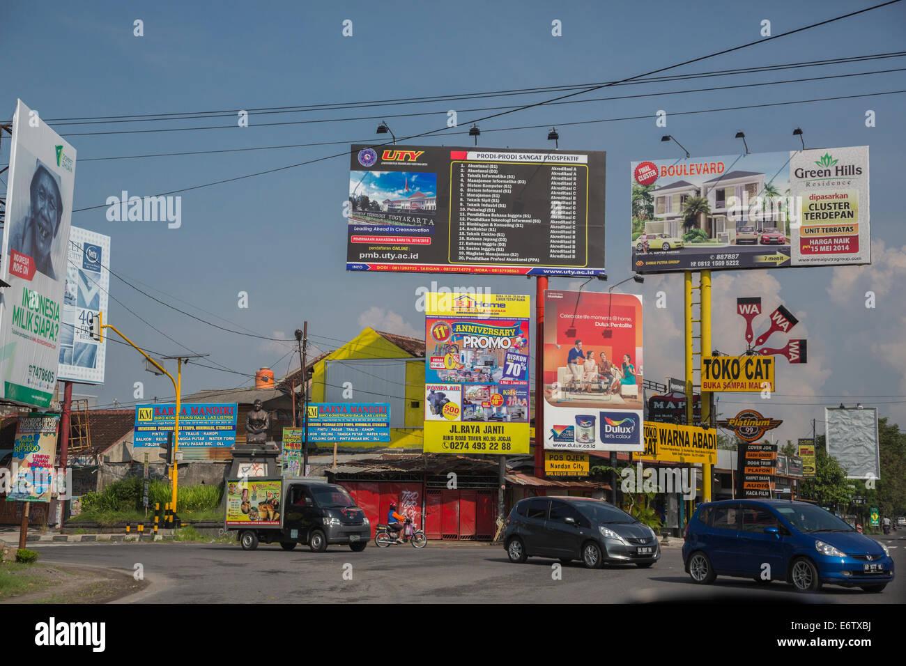 Yogyakarta, Indonesia.  Traffic Intersection, Advertising Billboards. - Stock Image