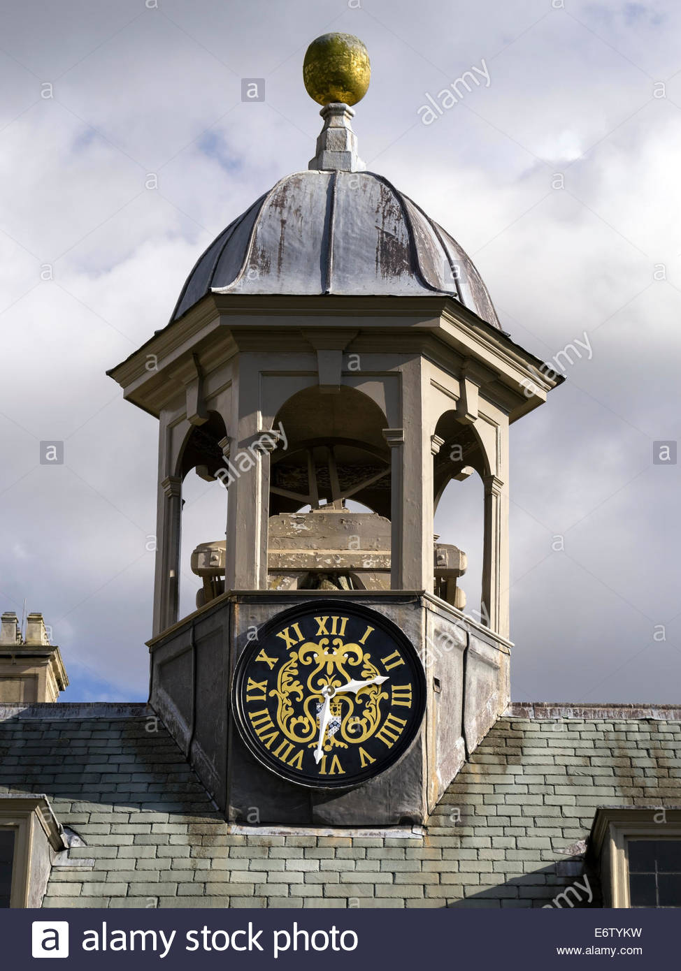 Old hexagonal clock and bell tower on slate tiled roof, Belton House, Grantham, Lincolnshire, England, UK - Stock Image
