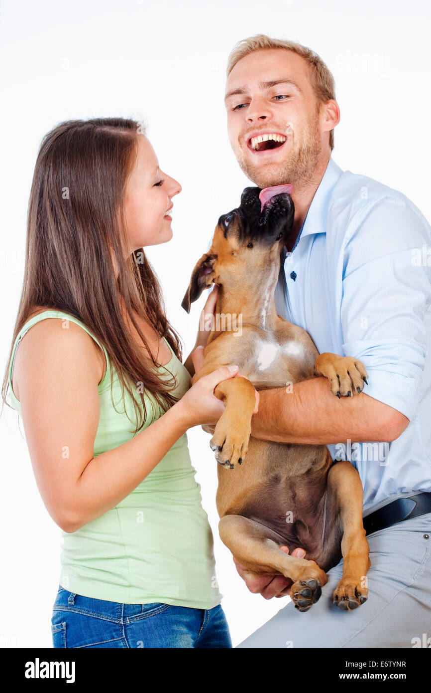 Portrait of a Happy Young Couple with a Dog. - Stock Image