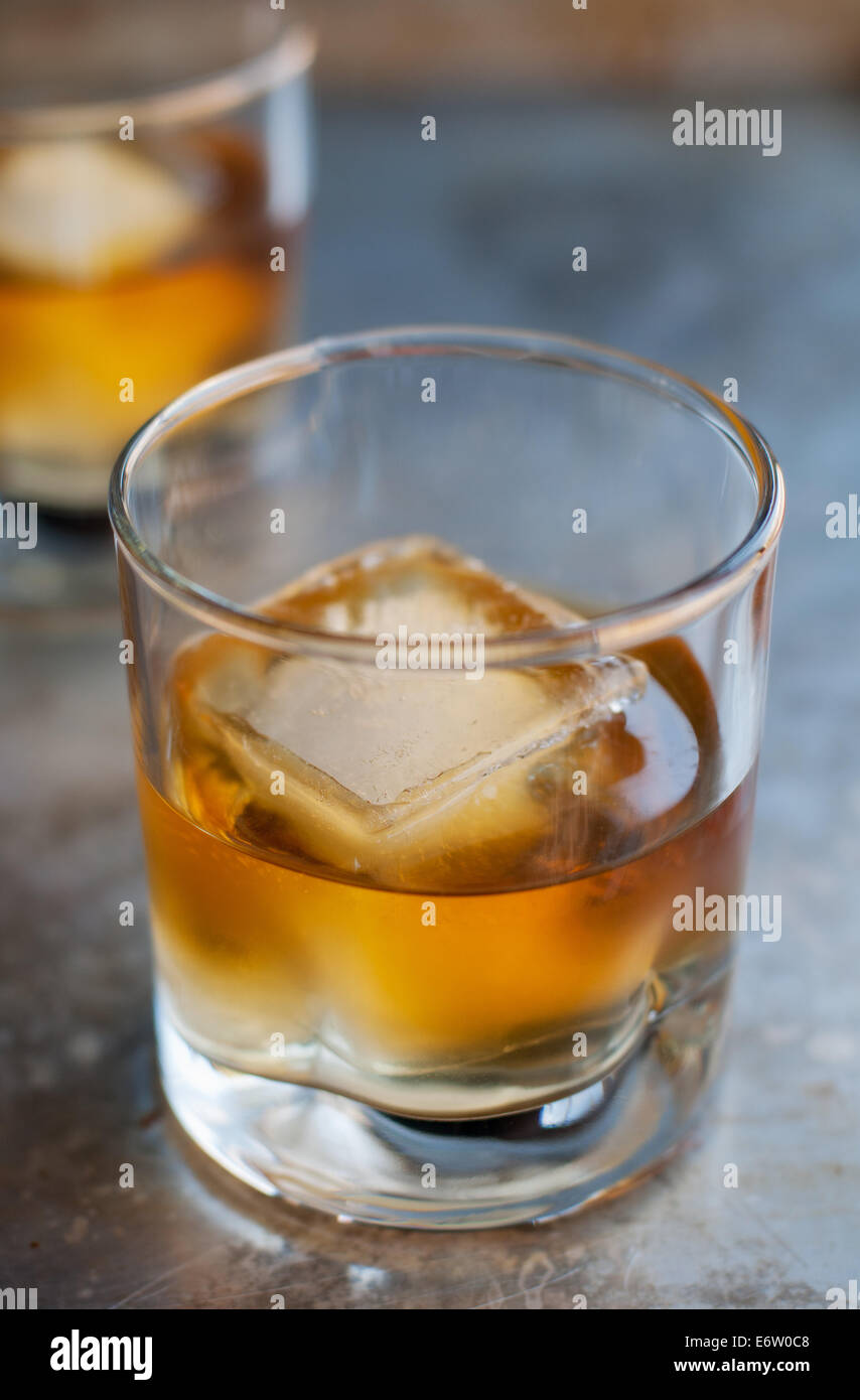 Glass of delicious aged single malt scotch whiskey on the rocks - Stock Image