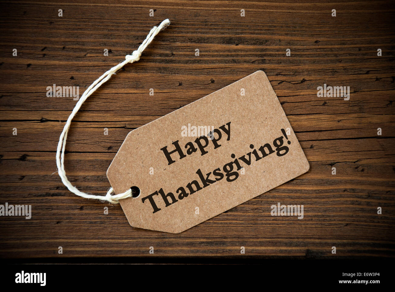 Rustic Natural Label With The Words Happy Thanksgiving On It Wooden Background