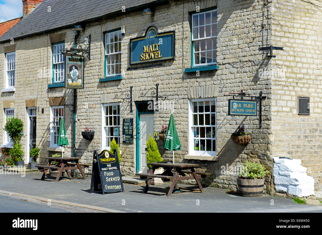 The Malt Shovel pub in the village of Hovingham, North Yorkshire, England UK - Stock Image