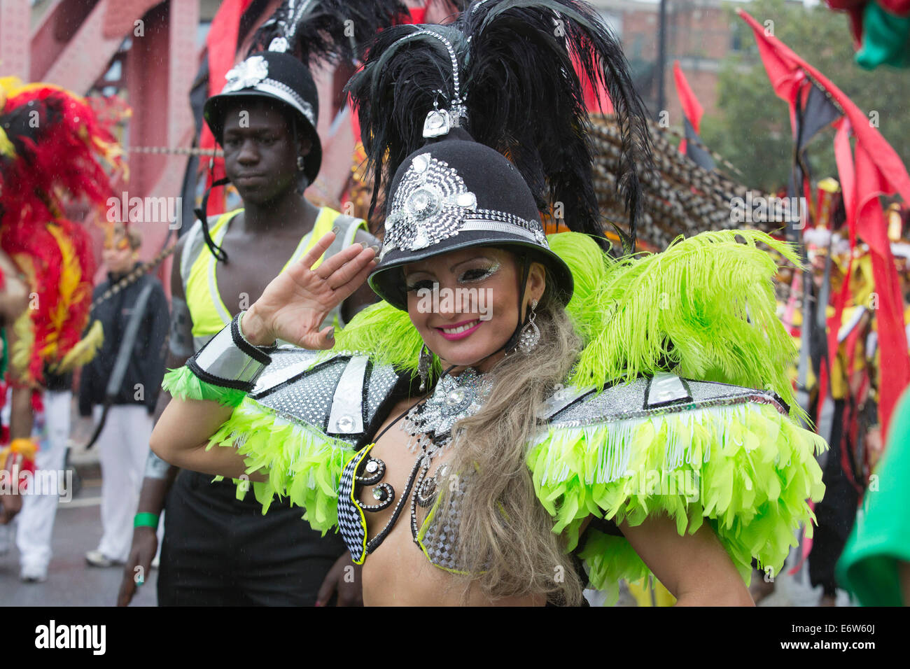 Samba Dancers from the London School of Samba at a rainy Notting Hill Carnival parade, London, UK - Stock Image