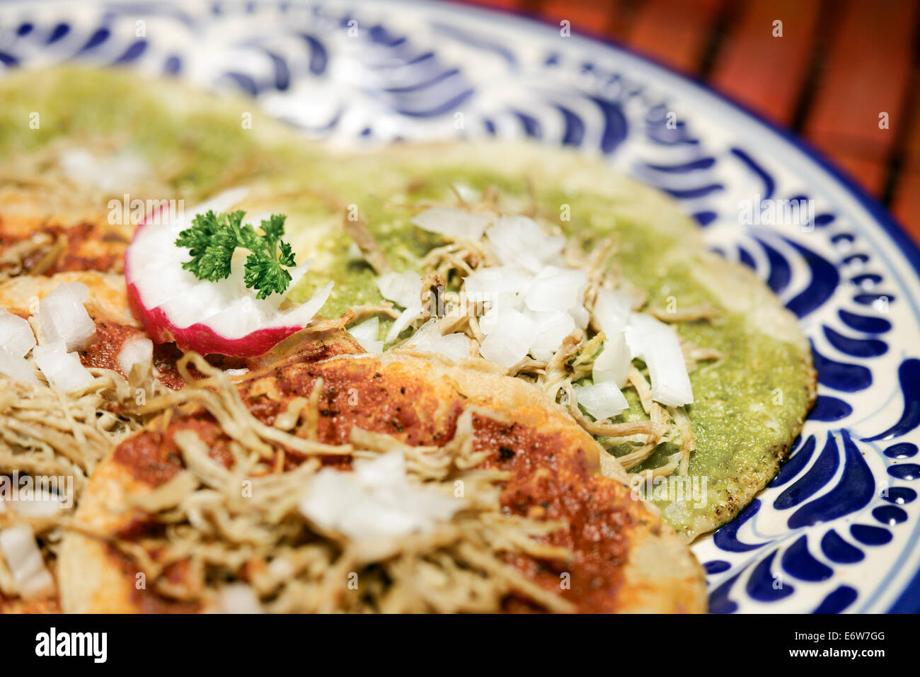 Green and red chalupas with shredded beef, a specialty in Puebla, Mexico. - Stock Image