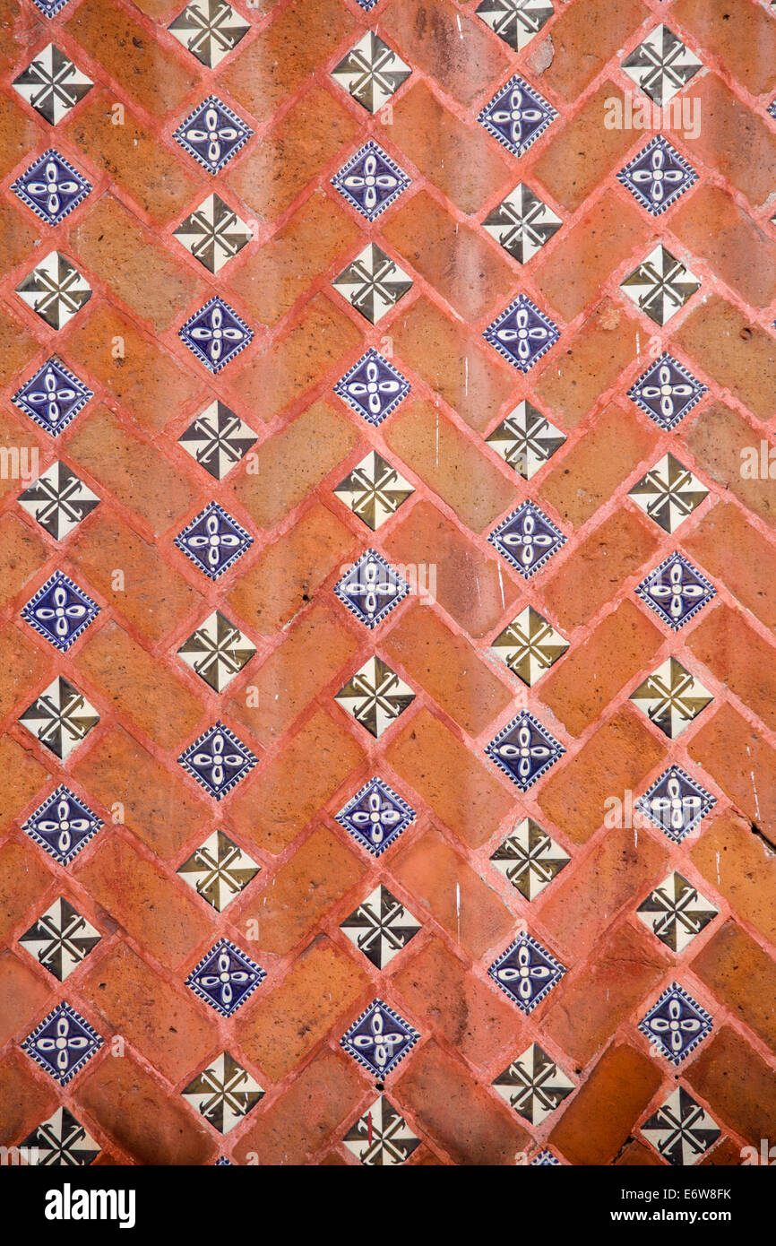 Detail of a tile and brick wall in Puebla, Mexico. - Stock Image