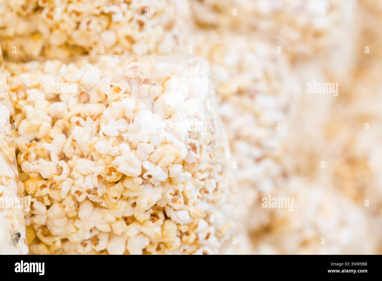 Many bags of popcorn at the local festival for sale. - Stock Image
