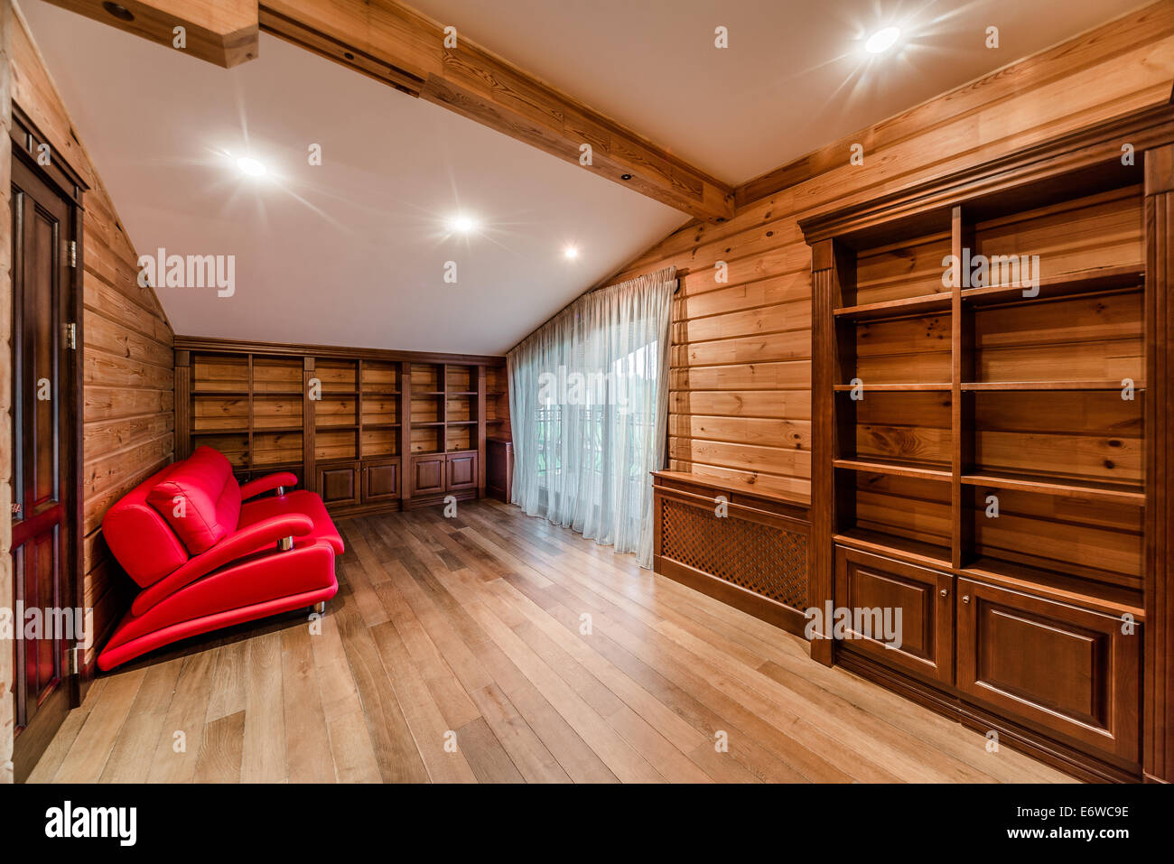 Interior of log cabin library - Stock Image