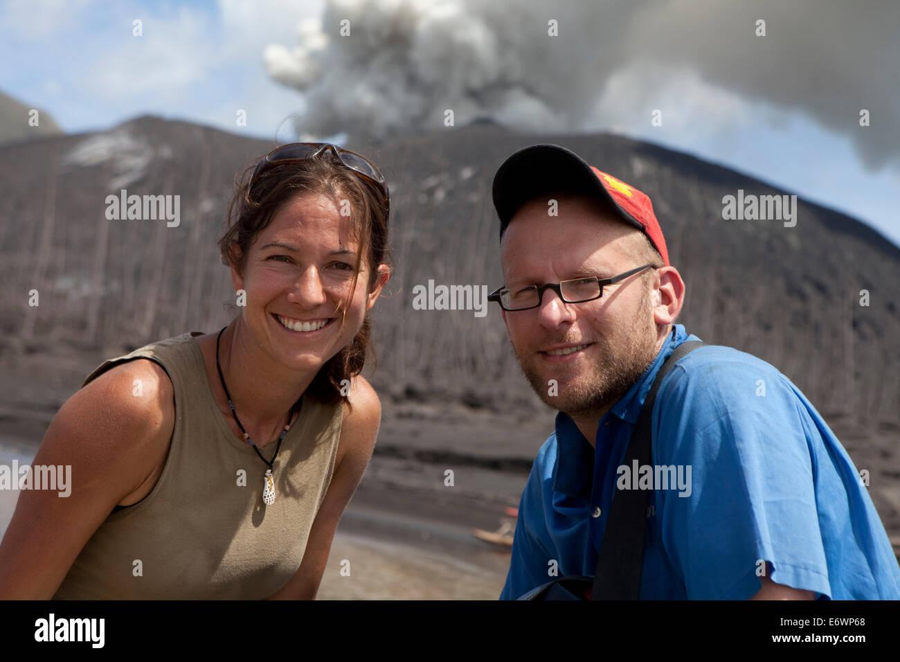 Roland Schulz, author for German GEO and Ulla Lohmann, photographer. Tavurvur Volcano, Rabaul, East New Britain, - Stock Image