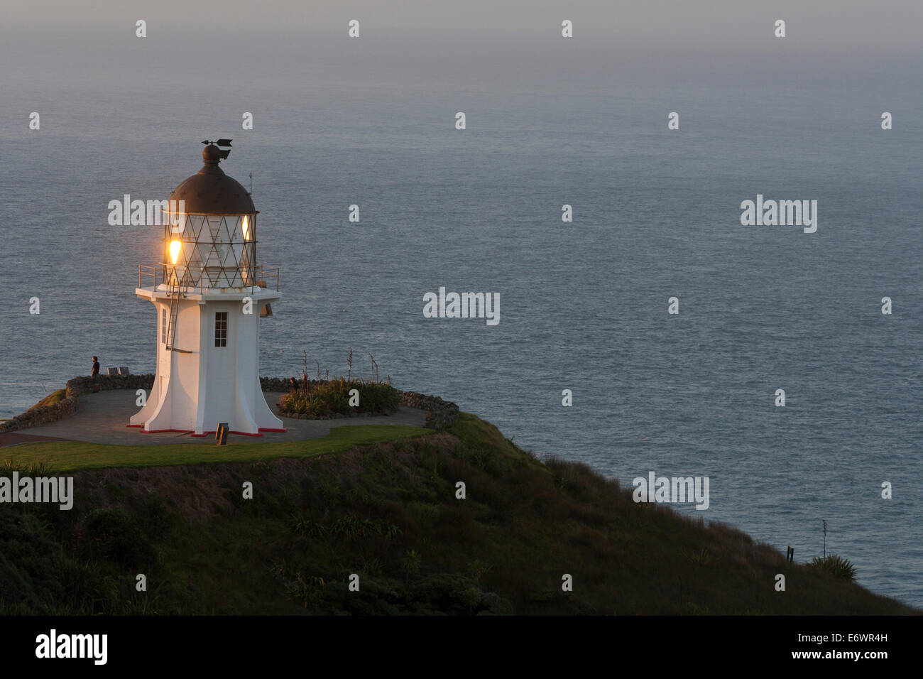 Lighthouse at Cape Reinga, Maori belief that the cape is where the spirits of the dead enter the underworld, most - Stock Image