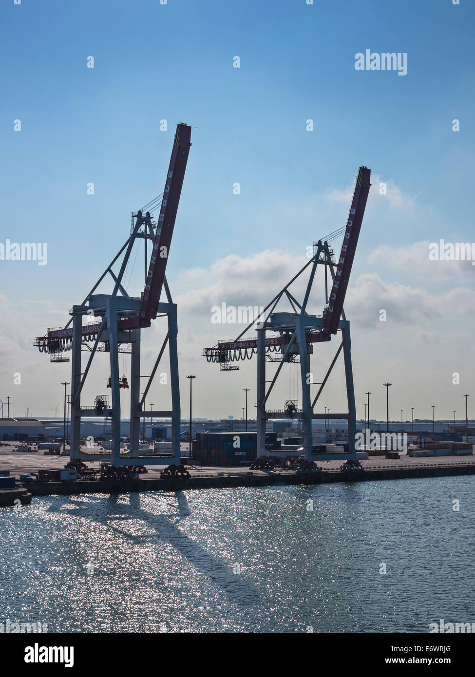 The container port at Dunkirk, taken against the light - Stock Image