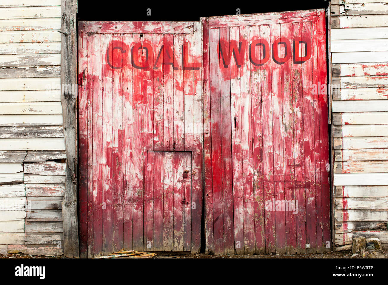Old red faded double doors, coal shed, North Island, New Zealand - Stock Image