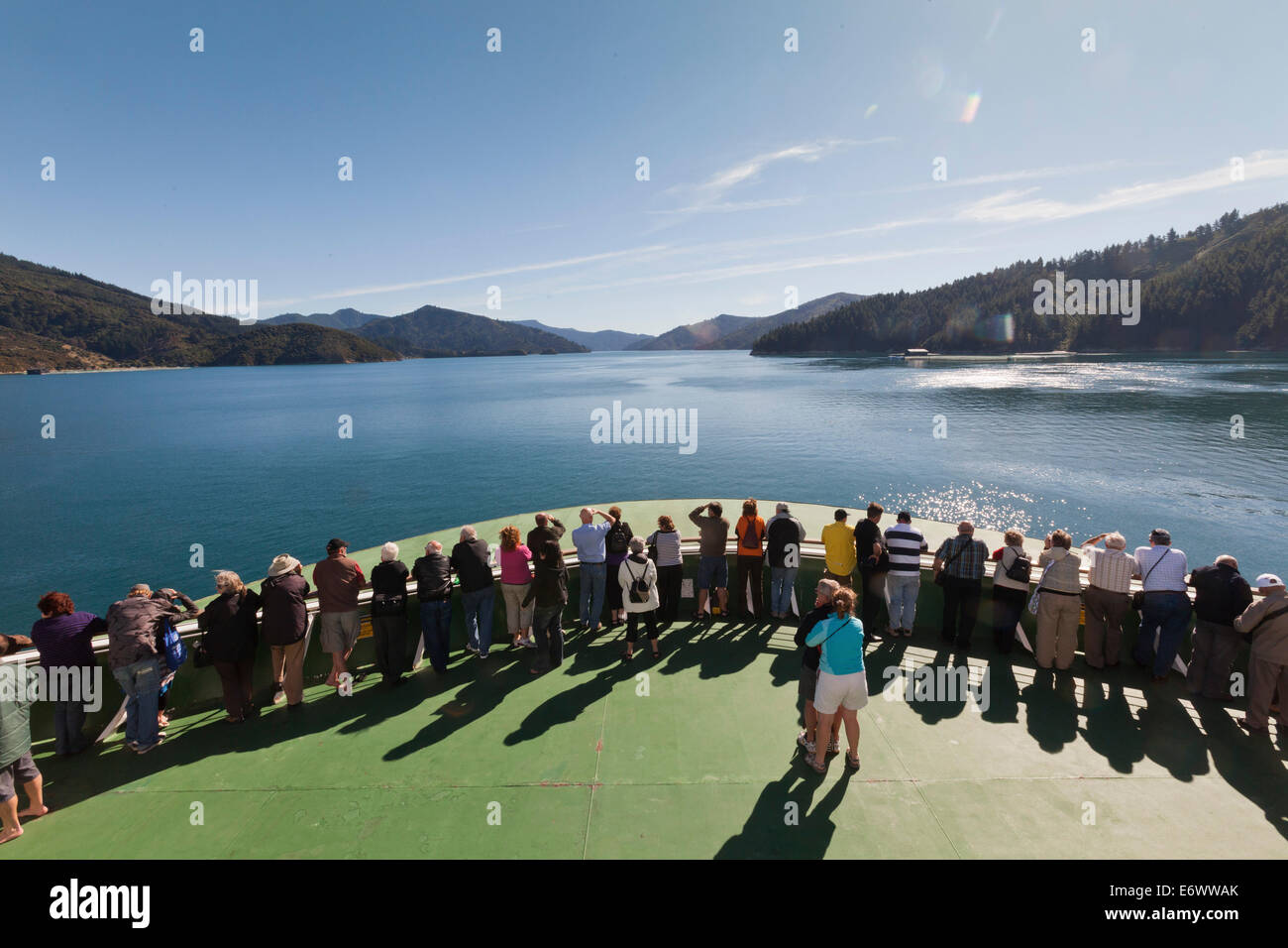 Passengers stand on the bow of the ferry boat entering Marlborough Sounds, Tory Channel, Marlborough, South Island, Stock Photo