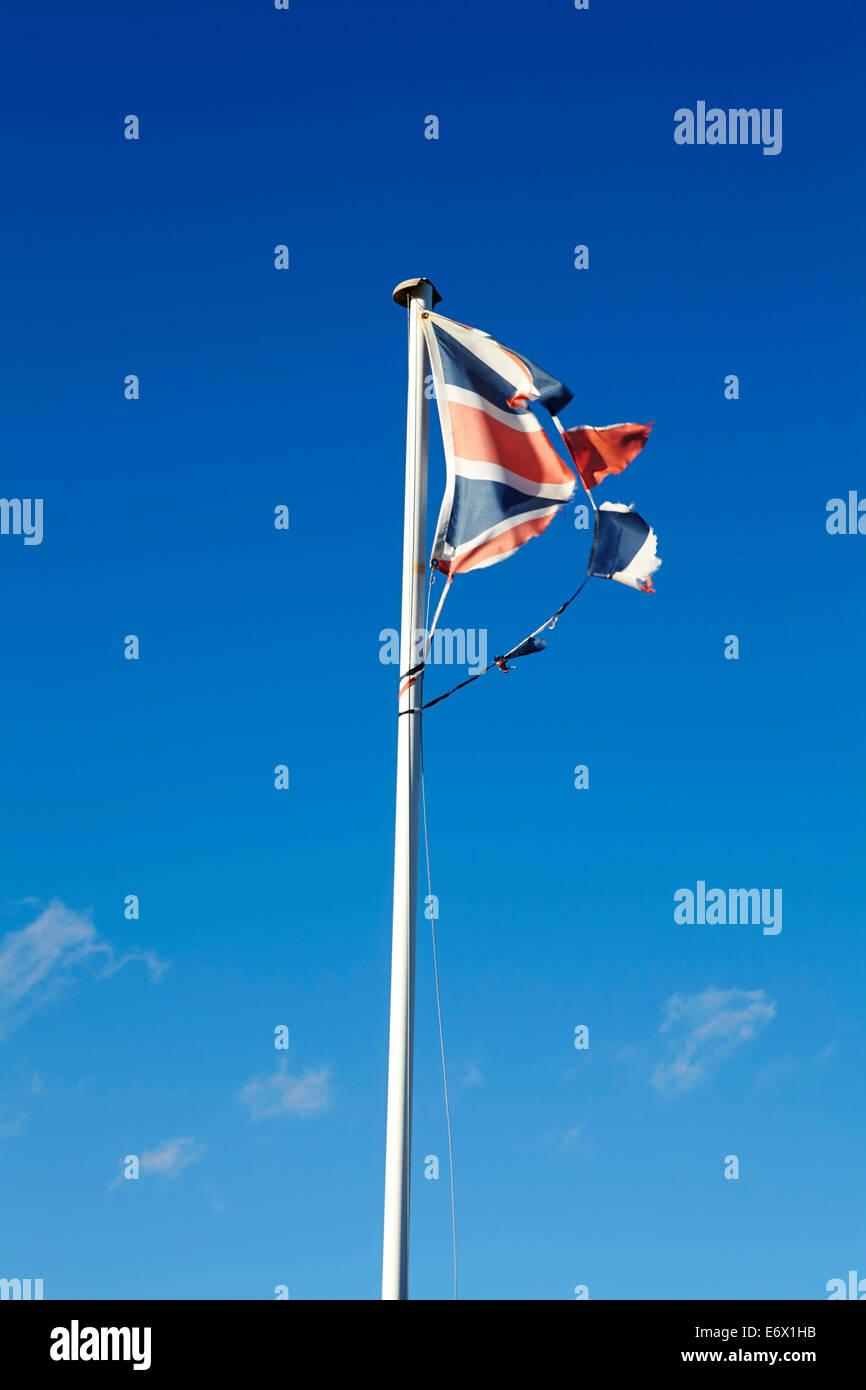 Tattered UK Union flag - Stock Image