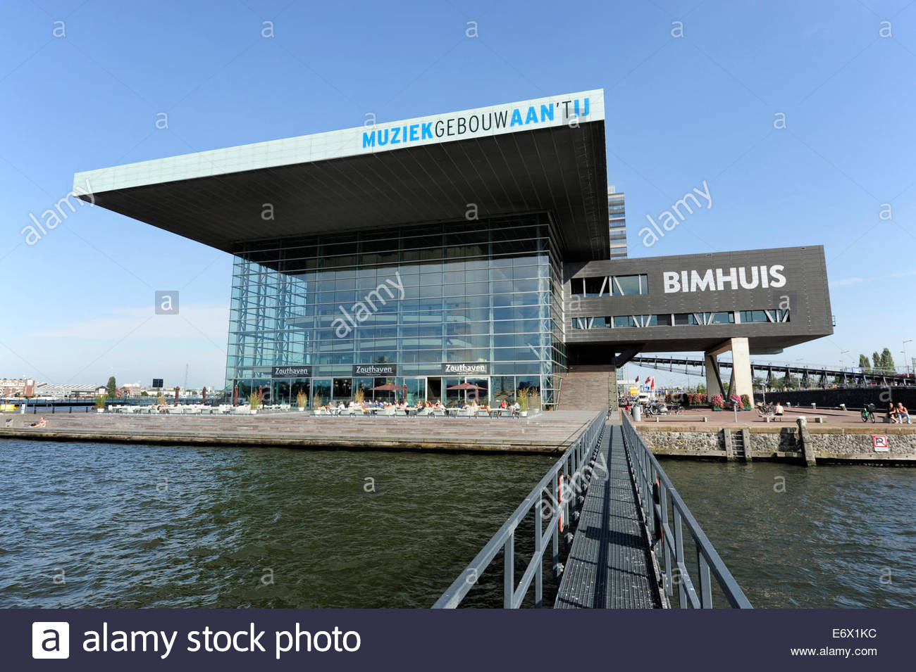 Modern architecture at the IJ lake, catwalk to a complex of buildings for music, Muziekgebouw aan het IJ and Bimhuis - Stock Image