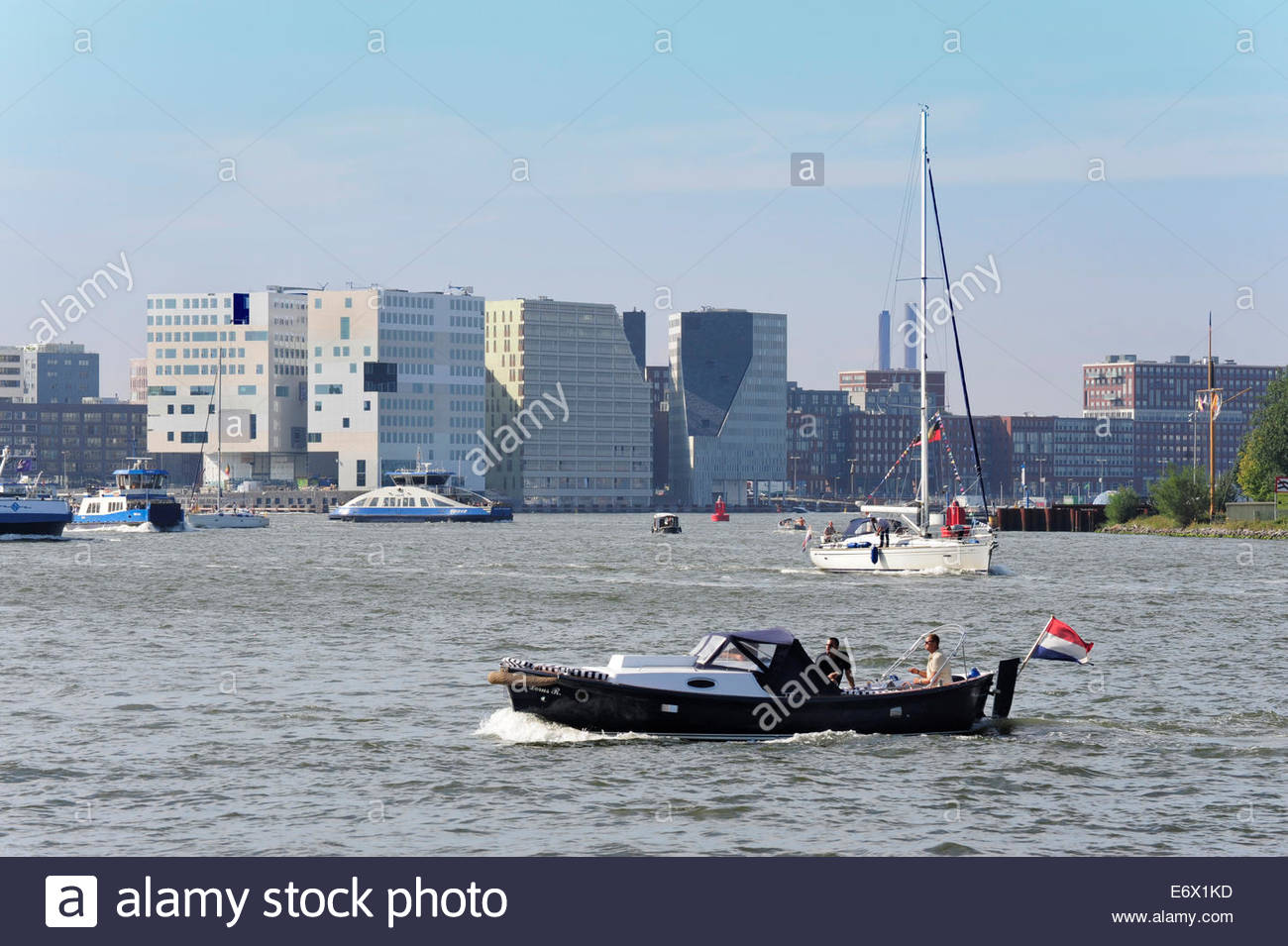 Boats on the IJ lake, at back modern architecture, IJdock and Westerdok, Amsterdam, Holland, the Netherlands - Stock Image