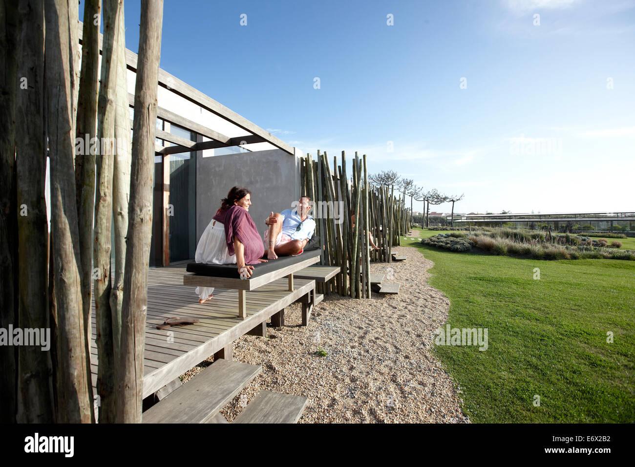 Guests on one of the private wooden decks, Hotel Areias do Seixo, Povoa de Penafirme, A-dos-Cunhados, Costa de Prata, Stock Photo