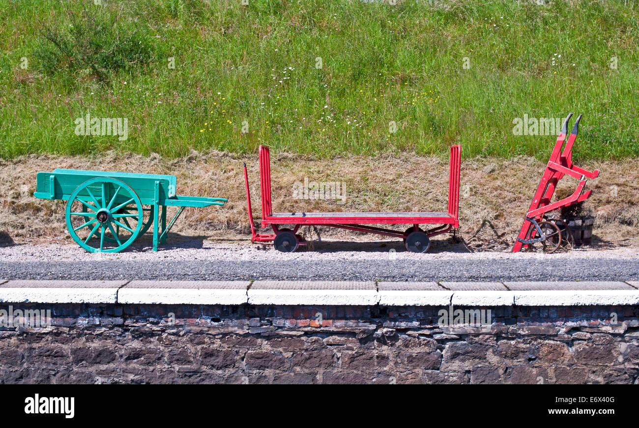 Vintage railway equipment on display on the platform at Boat of Garten station, Strathspey Steam Railway, Speyside, Stock Photo