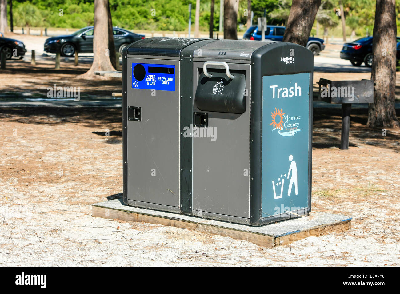 Modern seperated trash cans at the beach for paper and plastic bottles - Stock Image