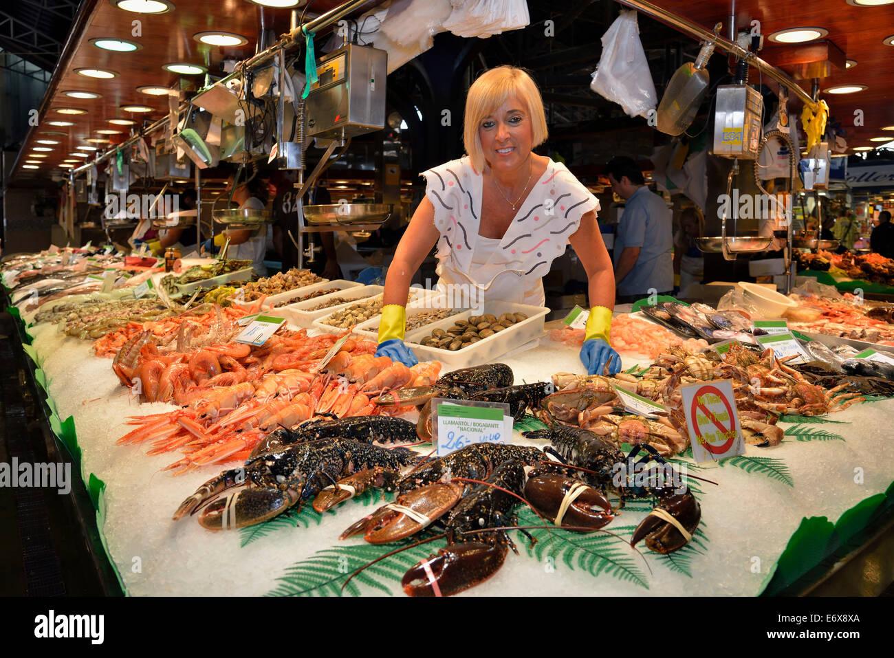 Fishmonger at her stall in the market hall, Mercat de la Boquería, also Mercat de Sant Josep, Barcelona, Catalonia, Stock Photo