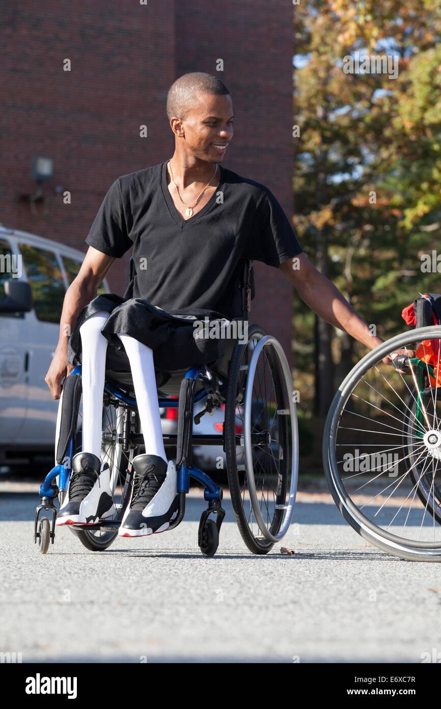 Man with Spinal Meningitis in wheelchair - Stock Image