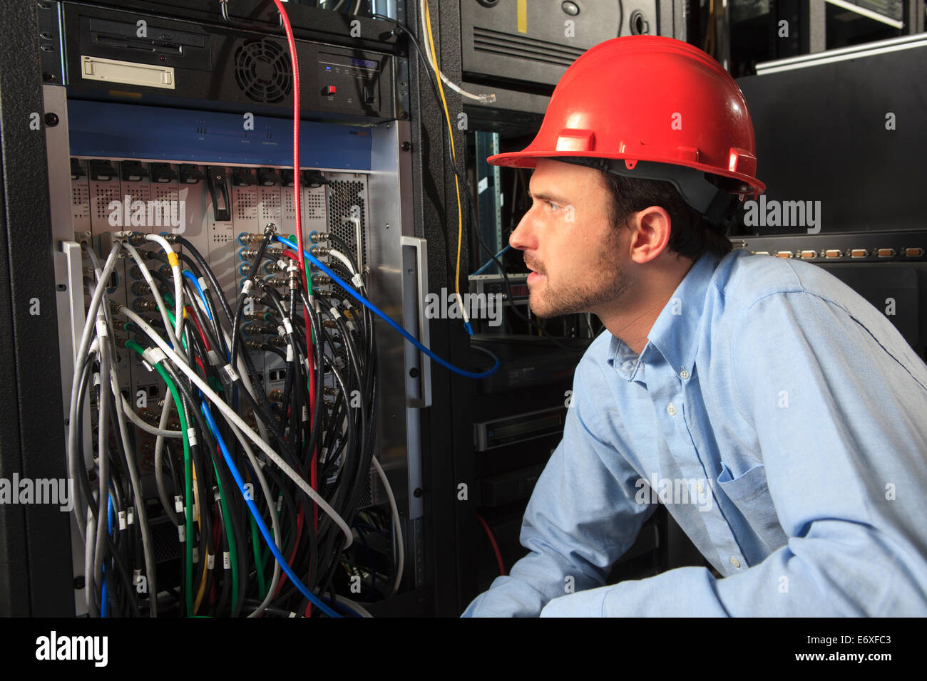 Patch Panel Stock Photos Images Page 2 Alamy Structured Wiring Cabinet Network Engineer Examining System Configuration At Image