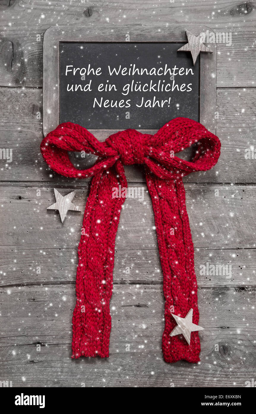 Chalk board with merry christmas message santa and snowflakes on chalk board with merry christmas message santa and snowflakes on wooden background with german text for a greeting card m4hsunfo