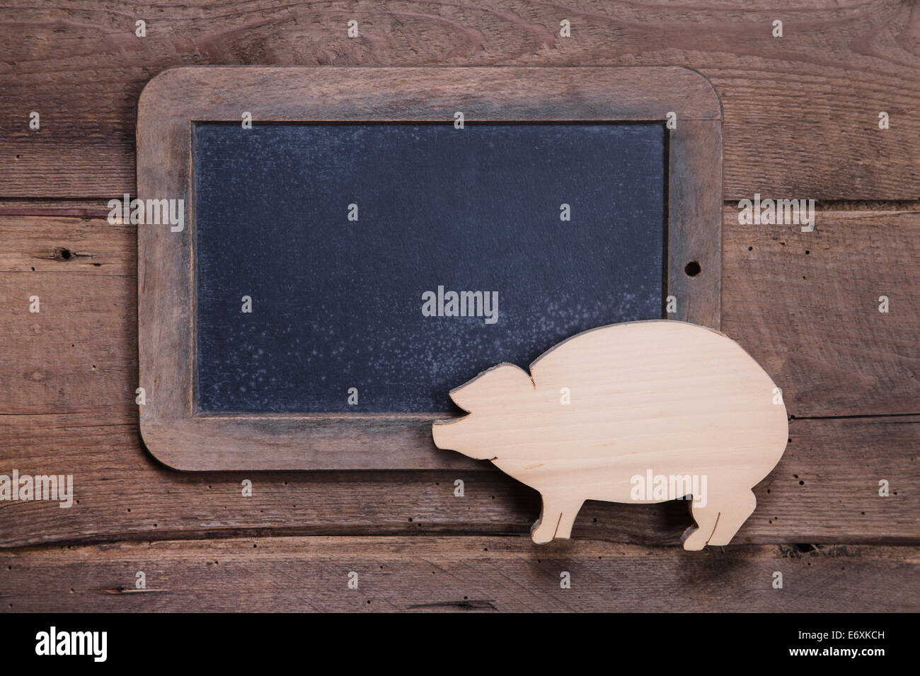 Menu board with pink pig on wooden background for New Year, sylvester, birthday or for a butcher - to say good luck - Stock Image