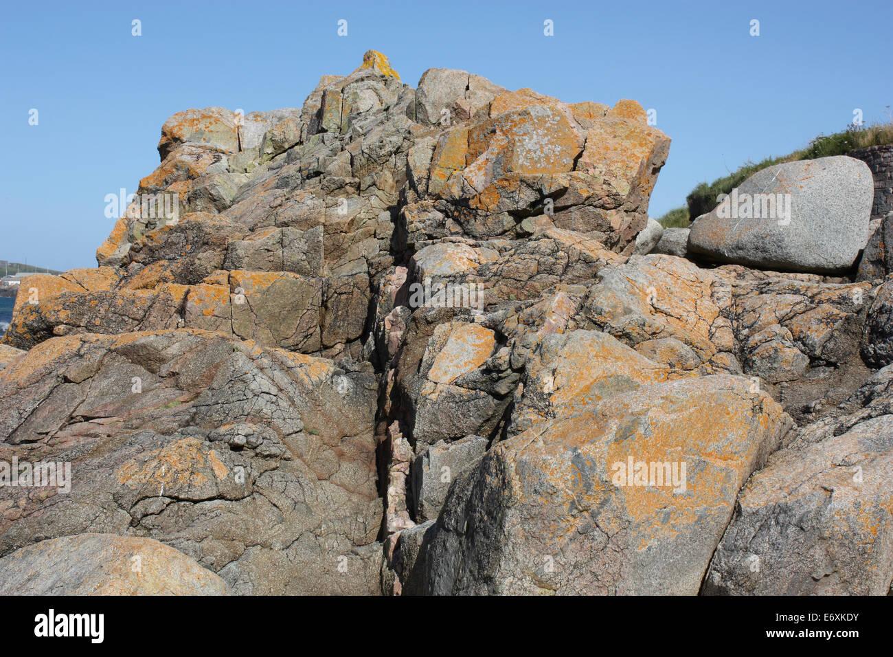 british channel islands alderney coastal rock formation stock