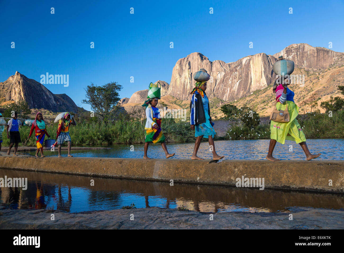 Madagascan women in front of the Tsaranoro Massif, highlands, South Madagascar, Africa - Stock Image