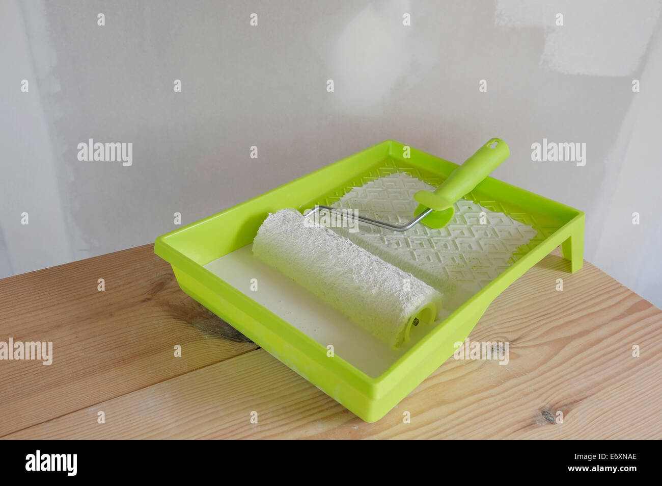 decorating roller and tray on table - Stock Image