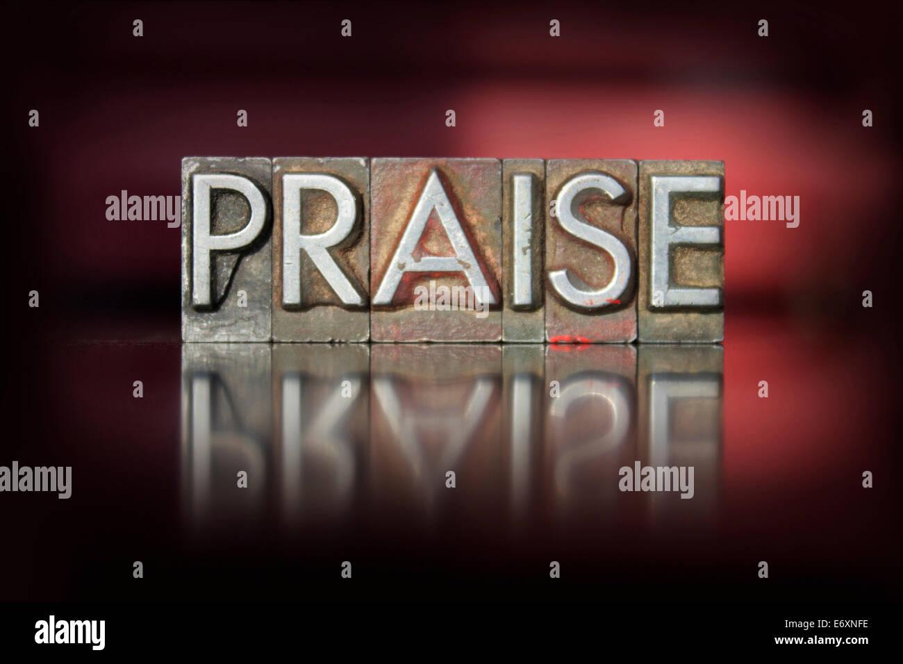 The word Praise written in vintage letterpress type - Stock Image