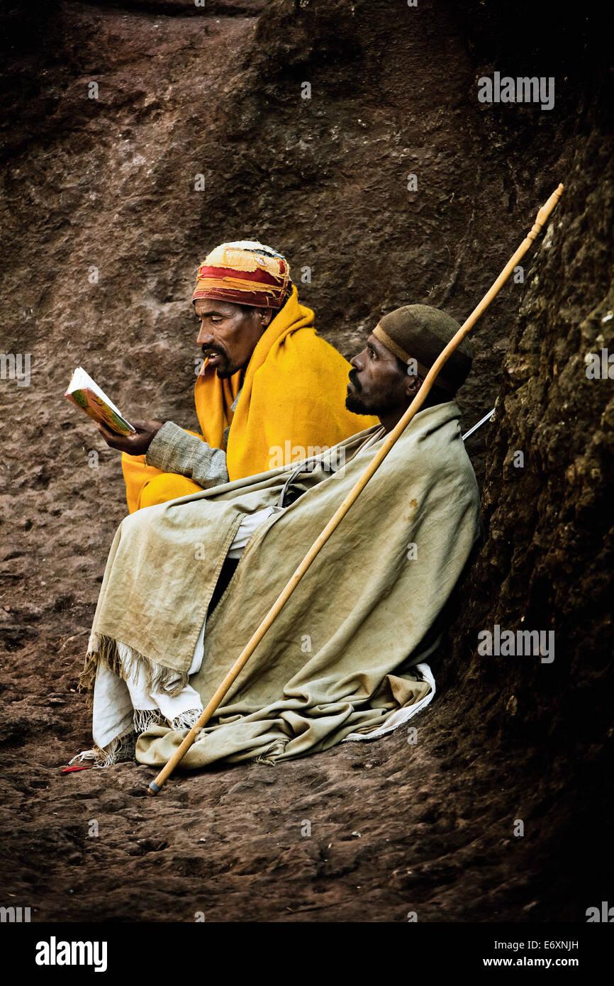 Two pilgrims sitting on rocks, Lalibela, Ethiopia, Africa - Stock Image