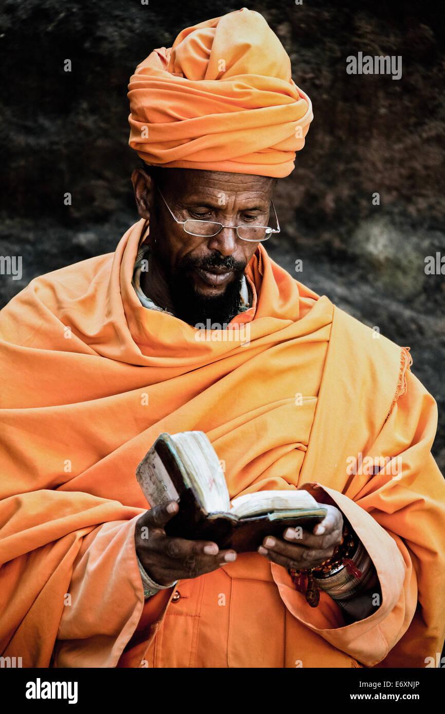 Priest reading the bible, Lalibela, Ethiopia, Africa - Stock Image