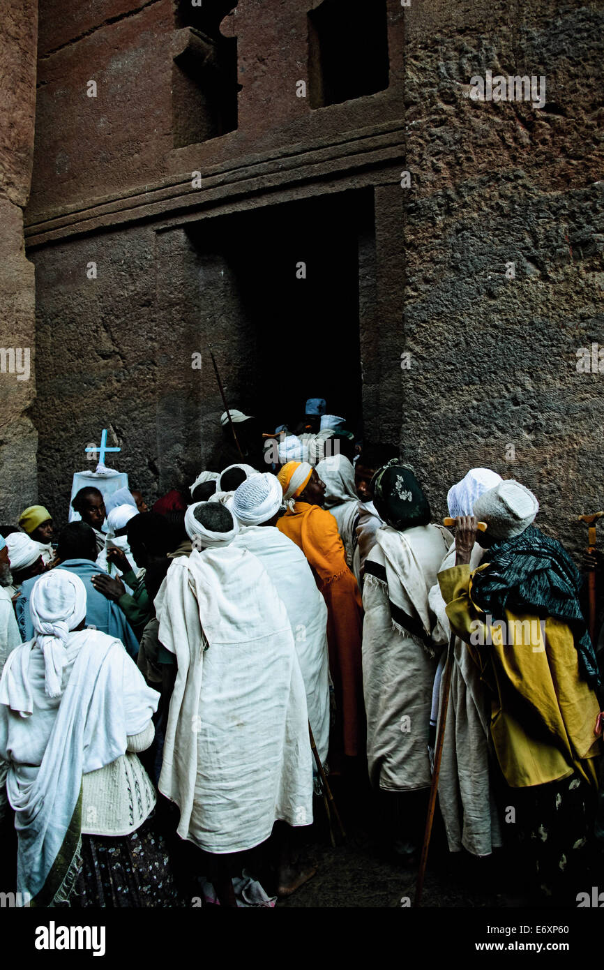 Priests entering a church in Lalibela, Ethiopia, Africa - Stock Image