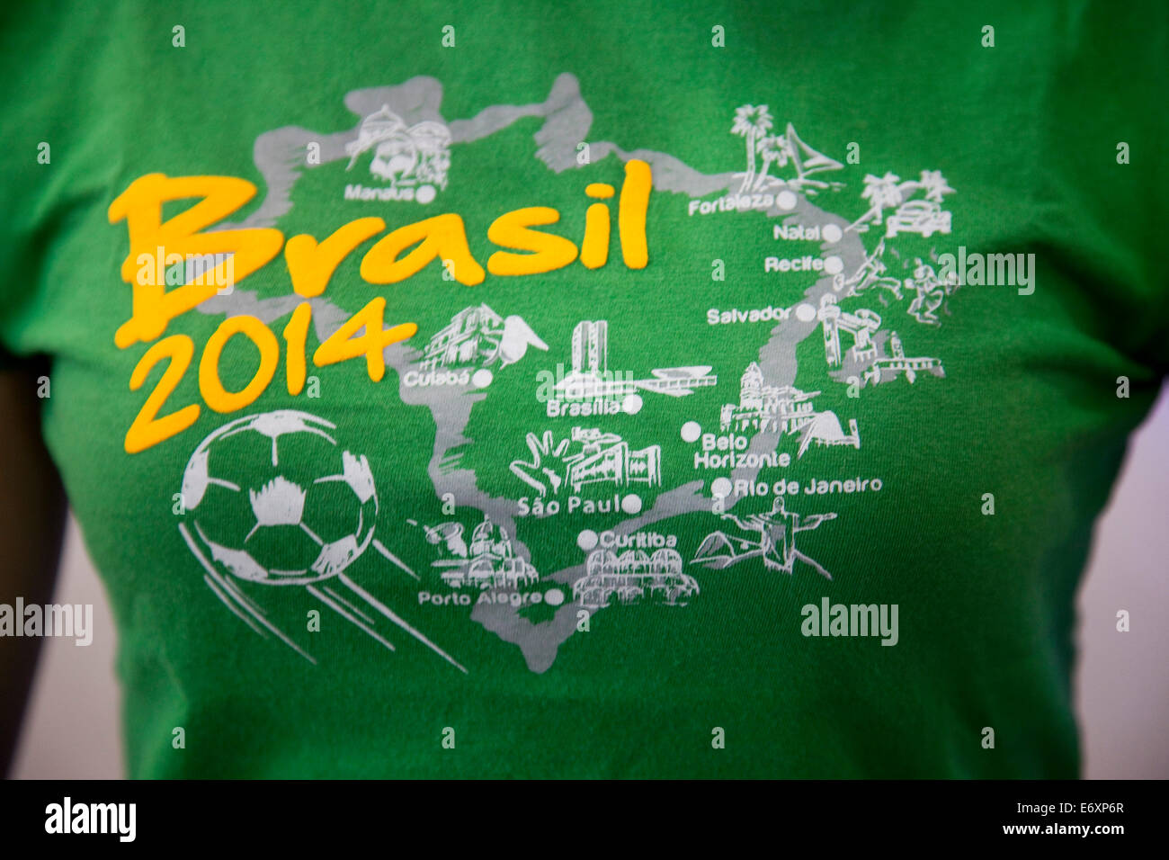 Woman wearing Brasil 2014 FIFA World Cup soccer shirt, Olinda, near Recife, Pernambuco, Brazil - Stock Image