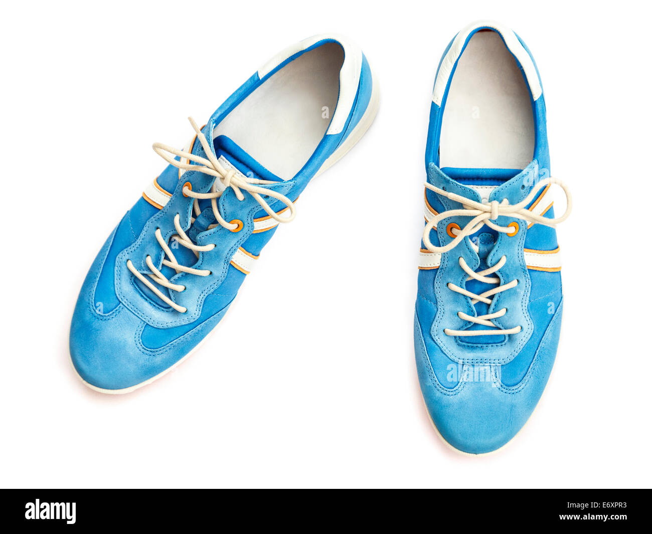A pair of ladies' new blue lace-up trainer style casual walking shoes sneakers cut-out and isolated on a white - Stock Image