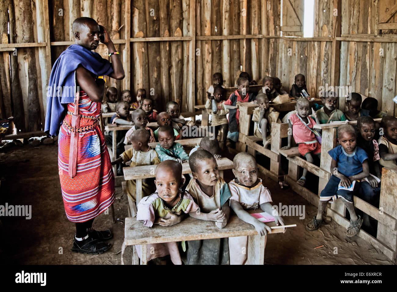 Children and teacher in a Massai village school, Kenya, Africa - Stock Image